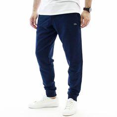 Семпъл #мъжки #спортен #панталон Oxxo със свободна кройка от еластична и удобна материя. Панталонът е в приятен #тъмносин цвят, има малка #бродерия отпред и #емблема отзад, предните джобове се закопчават с ципове за по-голям комфорт. Панталонът е подходящ както за #спорт и #тренировка, така и за ежедневието.