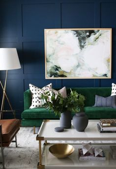 Studio McGee Formal Sitting Room. Love the dark wall, velvet sofa, and marble art.