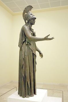 "The statue of the ""Piraeus Athena"" in the Archaeological Museum of Piraeus (Athens). The work has been given to either Kephisodotos or Euphranor (4th century B.C.), or deemed to be a Hellenistic-era creation in classicizing style."