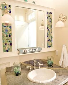 Sea Glass Adorned Bathroom Mirror: http://www.completely-coastal.com/2013/05/beach-bathrooms.html