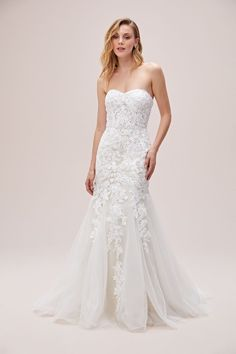 A figure-hugging mermaid wedding gown adorned with ornate floral applique. The illusion sheer bodice, allover lace, and tulle enhance this romantic look. Available in Sydney, Melbourne & Online. Country Wedding Dresses, Designer Wedding Dresses, Bridal Gowns, Wedding Gowns, Affordable Bridal, Wedding Silhouette, Wedding Costumes, Boho Bride, Beaded Lace