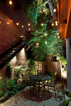 Courtyard design ideas - using string lights creates great atmosphere