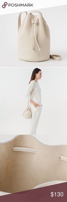 """Leather Drawstring Bag A perfectly simple bucket bag in supple, full-bodied leather, with a drawstring cinch closure.   Fabrication: Natural Milled Leather H 10.5"""" x W 7"""" x D 7"""" 23"""" Strap Drop Unlined Made in the U.S.A. BAGGU Bags Mini Bags"""