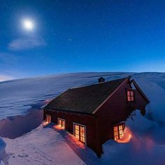 Snow covered cabin in the mountains  Photo by @espenhaagensen #LandscapesOfNorway