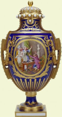 """1779-1782 French Sèvres Vase in the Royal Collection, UK - From the curators' comments: """"The front reserve of this elaborate vase depicts the jubilant scene of a father being presented to his newborn baby. The father, seated in a bergère (armchair) at a table in the Louis XVI style, throws up his hands in delight as he greets his son."""""""