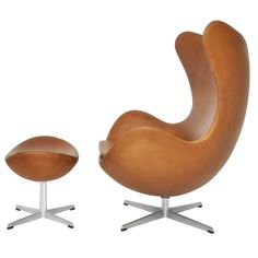 Arne Jacobsen Egg Chair and Ottoman...as a designer who makes stools the shape and legs are appealing to me