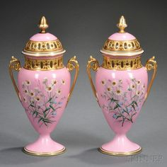 Pair of Limoges Pink Ground Porcelain Vases, France, late 19th century, gilded scrolled trim, pierced neck and cover, polychrome-enamel decorated with flowers