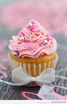 Pink Pearl Cupcakes. Now, I imagine the little silver candies might crack a tooth, but this is really pretty!
