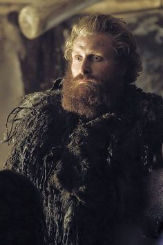 "Tormund Giantsbane.""Our ferocious chicken-eater here is my loyal Tormund. The woman -"" ""Hold. You gave Styr his style, give me mine."" ""As you wish. Jon Snow, before you stands Tormund Giantsbane, Tall-talker, Horn-blower, and Breaker of lee. And here also Tormund Thunderfist, Husband to Bears, the Mead-king of Ruddy Hall, Speaker to Gods and Father of Hosts."""
