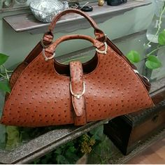 """GORGEOUS BROWN BAG NWOT Gorgeous Brown purse. NWOT  Inside zipper compartment  Lots of space inside  Addition long strap  Shiny patent leather  7""""wide 18""""long Bags"""