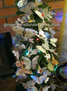 Punched Tin butterflies massing on my butterfly seasonal tree.  Tutorial for making butterflies on the blog.