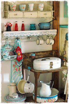 vintage treasures....enamel cake box, enamel holder, enamel water pitcher & pan, enamel coffee pot & pans....