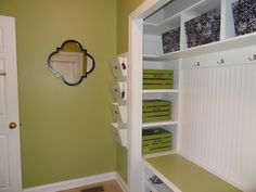 Turning a foyer closet into a mudroom-ish space.  Love the hidden shelving with coordinating wooden bins.