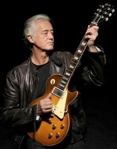 My favorite guitarist with my favorite guitar. This is Jimmy Page from Led Zeppelin holding his 1959 Gibson Les Paul. This combination is what initially made me want to start learning guitar. Jimmy Page, Jimmy Jimmy, Rock N Roll, Arte Pink Floyd, Blue Soul, Led Zeppelin Songs, John Bonham, Best Rock, Gibson Les Paul
