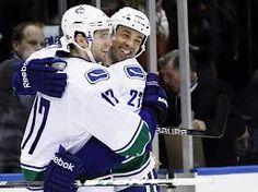 manny malhotra and Ryan kesler- Vancouver Canucks Ryan Kesler, Vancouver Canucks, Motorcycle Jacket, Hockey, Celebrities, Goal, Sports, Jackets, Sport
