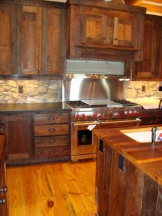 OLD BARN BOARD KITCHEN! And that stove!! Ohh man I'm in love