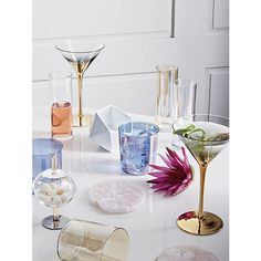 Shop Cylinder Irridescent Champagne Flute.   A magical iridescent finish gives this slim sipper its opalescent sheen.  Cylinder silhouette keeps the bubbly flowing at everyday parties or holiday fetes.
