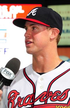 Todd Cunningham #30 of the Atlanta Braves is interviewed after the game against the Colorado Rockies at Turner Field.