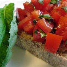 """Best Bruschetta Ever """"This is a great garlicky bruschetta recipe. Serve it on slices of French bread. It's a wonderful accompaniment to tomato pastas."""""""