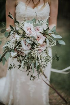 Wild pink rose wedding flowers. Photography by Natalie Pluck