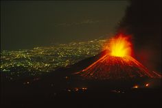 Picture of Piano del Lago erupting while the lights of the city of Catania shine below.