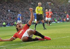 Manchester United striker Radamel Falcao slides on his knees after doubling his side's lead in the 32nd minute