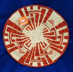 """You just cannot go wrong with this beautiful 14""""  handwoven basket for just 24.95 2.5"""" depth makes it perfect for fruit or party snacks. Beautiful enough to hang on your wall as a decorative accent piece! #basket #handwoven #homedecor #southwestern"""