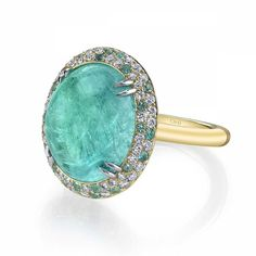 <p>One-of-a-kind Omi Privé ring set with a central cuprian elbaite tourmaline from Mozambique and smaller Paraiba tourmalines from Brazil, interspersed with diamonds.</p>