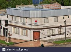 The hospital in Puerto Natales, Chile Stock Photo Chile, Medicine, Ocean, Clouds, Stock Photos, Mansions, Landscape, House Styles, Image