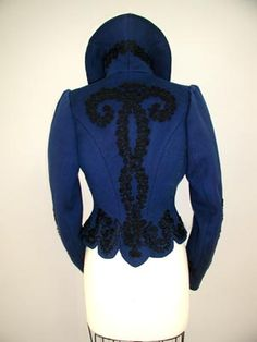 """1895 -1905 Deep Royal Blue womans jacket  Popular during the late Victorian period, high collars were common for not only daily clothing, but also appeared in outer garments as well. The outer circular collar is comprised of four trumpeted gore panels that stand 6"""" tall each. Sandwiched between the under collar and outer collar is the canvas interfacing that helps the collar to stand and roll back slightly. The under collar is self fabric that have the same four trumpeted gore panels."""