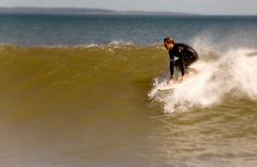 Surfing at Lawrencetown Beach, NS during tropical storm Leslie, Sept. 11, 2012. Photo by Steve Jess.
