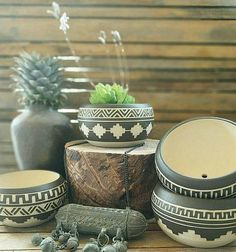I throw these vase on the wheel, then colored it with black slip, carved Accuracy by hand and fired at a temperature of 1200 º C to ensure its durability.  My inspiration for this vase came from the native america calture which I adore :)  Each vase get full Investment and get this unique look.  ►listing is for 1 planter(choose your favorite) ►Contains small hole in the bottom for drainage ►you will get the planter without the succulent :)  Vase measures (cm) 5.5-6cm high 8.5-9 cm in…
