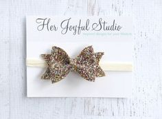 Fashionable glitter bow that can be made into a headband or hair clip.  My toddlers will only wear hair clips now so I love that there is an option for that.