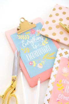 Making adorable DIY wall art with printables and clipboards.