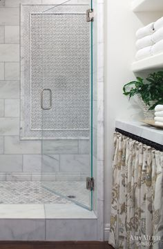 12x24? marble tiled shower with marble mosaic accent wall.  Amy Meier Design - bathrooms