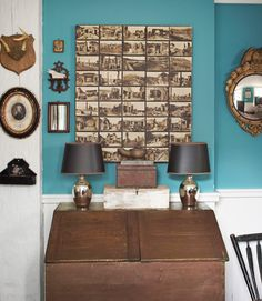 How to turn old postcards into a striking art display: Using bookbinder's glue, affix postcards to a large canvas then hang it to your wall.     #diy #art