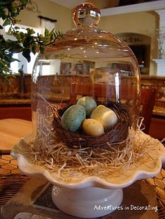 Cute & Simple Easter Centerpiece I have a wire bird cage with eggs and a nest for table then using a glass vase with branches and hanging eggs