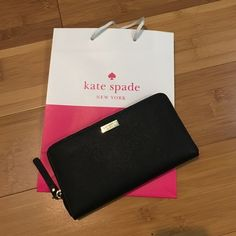 Kate Spade wallet Black zip around wallet, new with tag and care card. Offers welcome through the offer feature:) kate spade Bags Wallets
