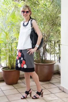 Wearing a printed skirt with plain white | 40plusstyle.com