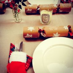 Christmas table with mini stockings to hold cutlery