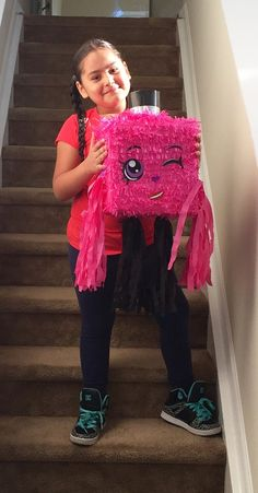 Handcrafted traditional hit with a stick piñata Holds Approx. 3-5 pounds of candy  Size is 10 x 10 x 6 Great Item for a Shopkins theme party or