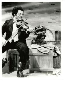 Itzhak Perlman and Oscar the Grouch.