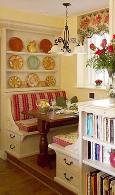 Built in kitchen 'booth' is such a great idea. It's welcoming. Love this with maybe a shabby chic pattern or colors!