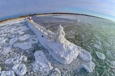 "Above St. Joseph Pier by Christopher Kierkus. He shares: ""We photogs are a little nuts ... especially scary is walking the little ""ice path"" around the inner light to get to the outer part. One sli..."