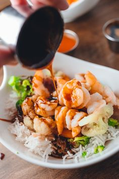 Mahatma Basmati Rice is topped with perfectly cooked shrimp and veggies and drizzled in a sweet teriyaki glaze for a delicious dinner idea.