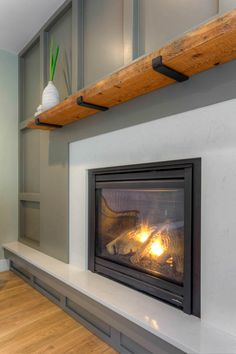 Reclaimed wood mantel  I  MICHAEL Construction, Kevin Hughes Photography