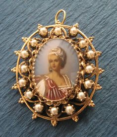 Antique Hand Painted Miniature Brooch 14 Karat Gold And Seed Pearls Lady Figural By Silverman Corp. $895.00, via Etsy.