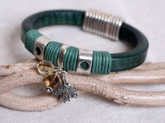 thinner leather wrapped would be pretty.....................................Forest Green Leather Strap Bracelet With Oak Lear & Faceted Wire Wrap Bead Dangles. $42.00, via Etsy.