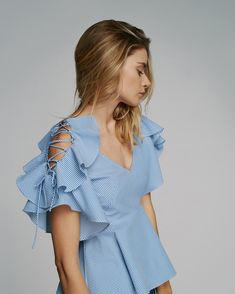 Marissa Webb - The cold-shoulder gets a whimsical update with the Abileen Seersucker Stripe Top featuring playful ruffles, lace-up shoulders, and a dramatic open back