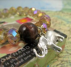Pradeepta Infinity Mala Bracelet in Gold Crystal with Silver Elephant Charm on Etsy, $25.00